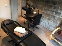 Nail desk and beauty bed in the treatment room. Garage conversion into beauty salon. Yorkshire stone feature wall with candles
