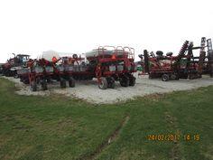 CaseIH equipment r-l:330 disk & 2 1250 corn planters of 24 & 16 rows