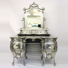 Fabulous & Baroque French provincial style Dressing Table. Adorned with four beautifully carved legs and three drawers on both sides with a brilliantly carved mirror sitting atop the vanity—along with an additional two drawers—this table is fit for a King or Queen. Highlight your home with the dramatic details of an opulent era—individually hand finished to create a truly authentic piece.