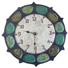 Nautical Wheel Ceramic Wall Clock is sculpted in low relief and slip-cast in low fire clay with low fire glazes by Beth Sherman of www.HoneybeeCeramics.com