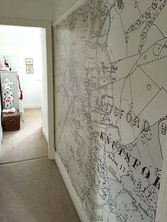 Narrow hallway with map wallpaper
