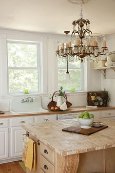 French Style Kitchen.  Love the hefty corbels under the counter.