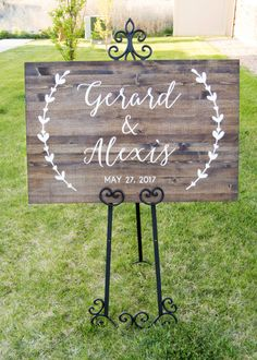 This classy wooden sign will make a beautiful personalized touch to your wedding or event.  This listing comes with 1 sign in the measurement and stain of your choice with the lettering in white. The pictures show our 24x36 (Horiz.) size in Dark walnut stain.  Because our products are made with real pine wood boards there will be differences from board to board Ex: knots, grain, stain saturation  Wood grain direction can be chosen on select sizes in the drop down menu (Horizontal or…