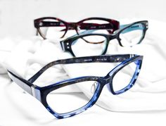 Ogi Eyewear Frames (from front to back): The 6001 in blue marble demi/blue marble, the 9067 in teal demi/transparent teal, and the 3101 in purple marble demi/purple marble.