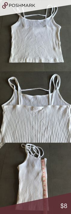 White spaghetti strap top Brand new white crop top with spaghetti straps. I only wore this once but I don't really like spaghetti straps. Feel free to make an offer.  ***i do live with cats so if you need me to wash it prior to shipping I can do that*** Tilly's Tops Camisoles
