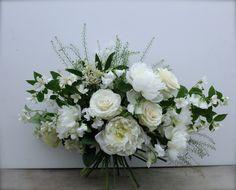 Beautiful bouquet of white peonies, Mondial roses, sweet peas & p hiladelphus. Heavenly scented.