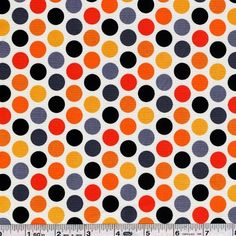 Lively, multicolored dots feature a fun Halloween palette! This quilting weight fabric is 43/44