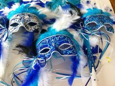 A seriously offbeat bouquet alternative ~ venetian masks!