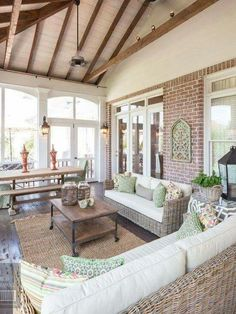 Lovely, but functional screened-in porch! Love the exposed brick and high ceiling.