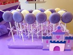 Purple ombré decorations and Sofia the First inspired handmade decorations for the dessert table. Large age number (3) display with painted wood castle and cute cupcake/cake stand with tulle skirt are some of my favorites! Purple/cream macaroon pops, purple cupcakes, purple polka dot heart/3 cookies, Princess fruit wands, and bundt cake complete the sweet treats selection