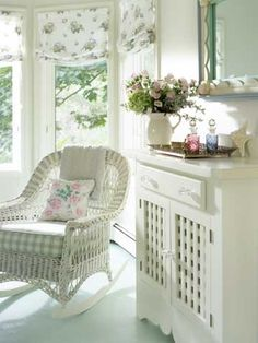Wicker brings the feel of the porch inside. Look for wicker rockers or settees at Pier 1 or World Market. For a vintage look, add cushions at least 6 inches thick.