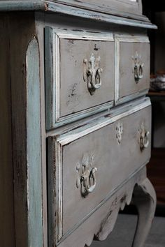 Annie Sloan Chalk Paint. Three colors with distressing and wax.