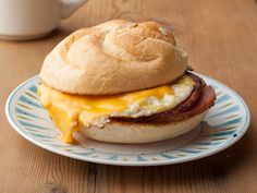 New Jersey Pork Roll Sandwich With Egg and Cheese -- For an authentic Jersey breakfast, layer pork roll (a SPAM-like meat) with a cheese-smothered egg between toasty buns. #AcrosstheCountry