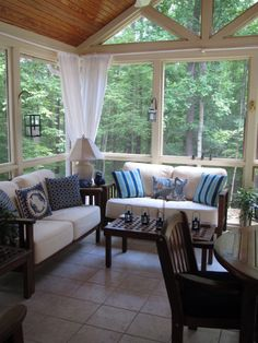 Sunroom inspiration.  Love the lantern sconces and the curtains in the corners of the room.  Really need to paint the walls a lighter color like this