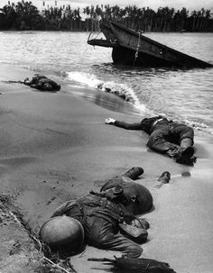 """Caption from LIFE. """"Three dead Americans on the beach at Buna."""" Why publish this was explained in a 1943 issue. """"The reason is that words are never enough. The eye sees. The mind knows. The heart feels. But the words do not exist to make us see, or know, or feel what it is like, what actually happens. The words are never right. . . ."""" & """"And so here it is. This is the reality that lies behind the names that come to rest at last on monuments in the leafy squares of busy American towns."""""""