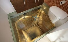 Bathroom in a private home over an abandoned elevator shaft.