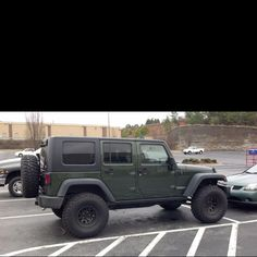 Green Jeep with black