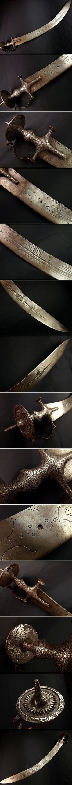 Indian tegha sword, 18th century, large and massive 36 inch sword with a 32.5 inch blade, 2.5 inch wide, silver koftgari tulwar hilt.