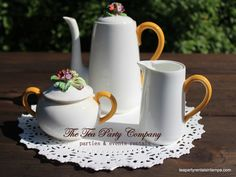 perfect for a fall theme tea party!!!! bone china made in England tea pot set