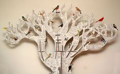 Tree made from bookpages, birds cut out of old illustrated encyclopedia