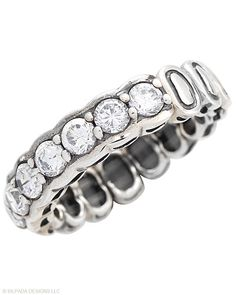 This two-looks-in-one Sterling Silver and Cubic Zirconia Stretch Ring springs to life! Fits sizes 6, 7, 8.