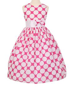 She'll be party-ready in this retro-inspired dress featuring whimsical polka dots, a fun bow accent and a sweet flared skirt.
