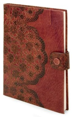 This buffalo leather journal is embossed with an antiqued lace design.