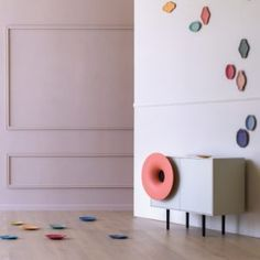 """Caruso is the """"dancing"""" cabinet that changes completely the traditional furniture concept. With an iconic and distinctive design, it matches different materials: the precious and flexible ceramic applied on the outside part of the """"trumpet sound speaker"""" with the straight and severe furniture structure outlines. Caruso includes a HI-FI system. The Bluetooth 4.0 connection offers a rich and unexpected high performance sound. 
