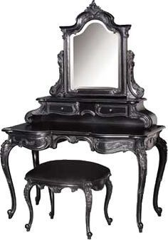 Fabulous vanity. Could do with some dark red or dark purple cushions, though. Or black and white stripes…