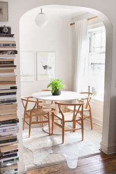 between the archway, the books, the table and chairs, chandelier, and rug, you would never notice the ugly linoleum. designed to perfection! via pop sugar