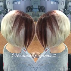Platinum blonde hair with a burgundy panel and an angled Bob