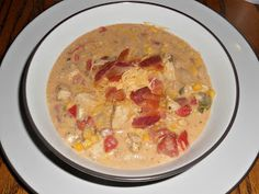 Jalapeno Popper Chicken Chili topped with bacon