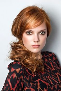 Hairstyle 2013 - Long curly red hair in side ponytail.