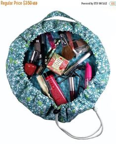 The Ana Cinch-Up Makeup Bag will be a great addition to your organizing and travel needs. The large open design makes it easy to view and use all your items inside. To close, just a pull on the cord string lock and everything gets cinched up safe! An outside handle makes it easy to carry.