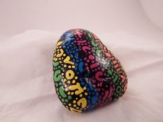 Painted Rock,Original Design,One of a kind mult-colored. Smooth, fun shape ,All sides completed.Abstract, Artist signed