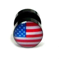 Dilatación falsa con diseño bandera USA en ambas caras. Fondo negro y banda amarilla, verde y roja. Acero quirúrgico. Diámetro: 10mm Grosor: 1,2mm. EEUU