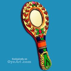 Hand Held, colorful, handcrafted papier-mache mirror. The frame is creatively designed with a vibrant assortment of colorful paper plain & patterned. Get Here http://bit.ly/1MQWrmX