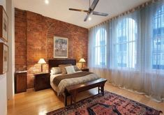 Bedroom red brick walls and ceiling fan