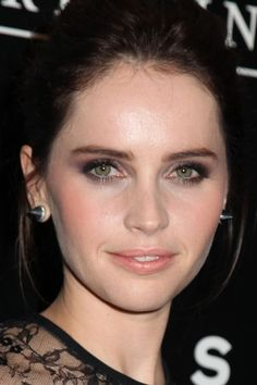 "4 Steps to Perfectly October-y Smoky Eyes Like Felicity Jones: ""I took Moire [dark purple] from Votre Vu Palette Play in Violette and applied that on the outer corner of the eye and blended it inward, so less color would be toward the inner corner to create that gorgeous gradient effect."" -- Sabrina Bedrani, celebrity makeup artist"