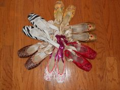 "Decorate your old pointe shoes! Use a light coat of spray paint for the base color (Avoid getting any on the ribbons as they will harden.) Then add designs with permanent markers. If you want a more ""professional"" look, stuff the inside of the shoes with paper towels to keep them from getting sprayed on the inside and cover the leather portion so that it stays its original color. Hang them in your room as decorations or use them for pictures!"