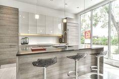 O'Cartier Condominiums Showroom - in collaboration with Groupe TDR Pont Viau Laval COUNTERS: Caesarstone Quartz: Blanc Organic #4600 and Quartz Raven #4120 FLOORS: Fanal Habitat White et Dark Grey #Caesarstone #quartz #Fanal #tiles #interiordesign #condos #interiors #design