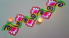 Beautiful Diwali Rangoli Designs for Side Border With Candles Simple Rangoli Border Designs, Simple Flower Rangoli, Easy Rangoli Designs Diwali, Free Hand Rangoli Design, Rangoli Borders, Small Rangoli Design, Rangoli Patterns, Rangoli Ideas, Rangoli Designs With Dots