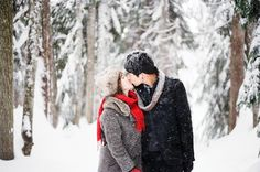 A kiss in the snow! Love their winter engagement shoot outfits | Nadia Hung Photography