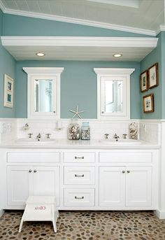 this is the perfect summer house bathroom with shiplap walls, a