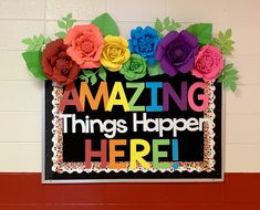 Amazing things happen here! Colorful bulletin board with large hand-cut paper flowers and Cricut lettering. Flower Bulletin Boards, Colorful Bulletin Boards, Office Bulletin Boards, Summer Bulletin Boards, Bulletin Board Letters, Paper Flower Backdrop Wedding, Paper Flower Wall, Giant Paper Flowers, Classroom Wall Decor