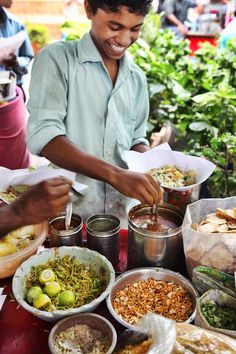 Delhi, India ~ Bhel Puri: The main ingredient in this tasty street food is crispy puffed rice, similar to Rice Krispies, with the addition chopped onions and coriander leaves, boiled potatoes,  multiple chutneys and a squeeze of lime.
