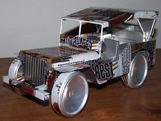 Aluminum #Jeep made up of 17 twelve oz cans and 10 juice cans (5.5 oz). Created by Tesscar Aluminum #Craft.