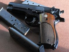 Old school and still one of the best - S&W 39-2 9mm - great gun