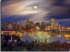 https://flic.kr/p/5ovwuo | Denver Skyline | Full moon rises over the Denver skyline. I shot this one from a restaurant on the top floor of a hotel, right next to Mile High Stadium (where the Denver Broncos play) It is a very long time exposure.