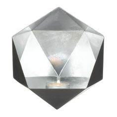 This wall sconce is a modern marvel of fantastic design! Its black exterior gives way to a faceted silver interior that will bounce the candlelight from a single tea light out into your room. Weight 0